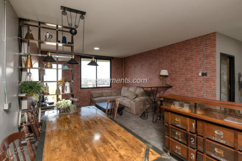 wood table in living room area of two bedroom condo