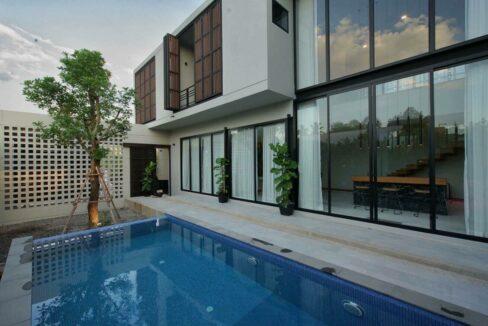 pool area modern three bedroom house