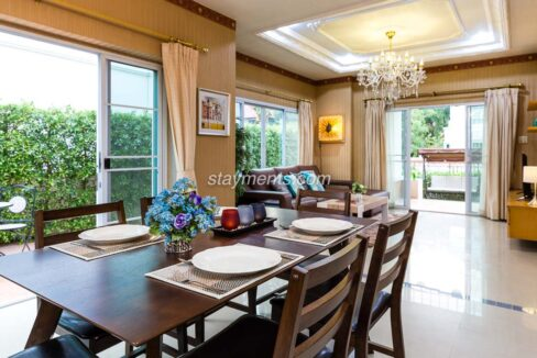 House for sale - Open plan living and dining room with chandeliers