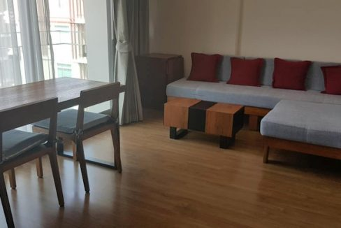 furnished living room - one bedroom condo rent at the nimmana