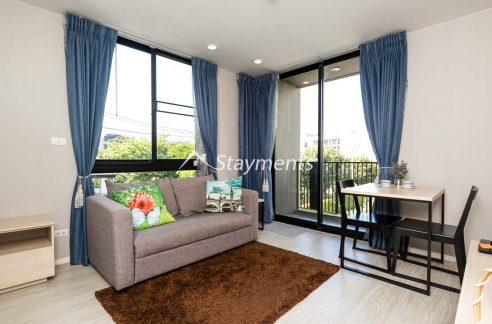 living room area in one bedroom condo