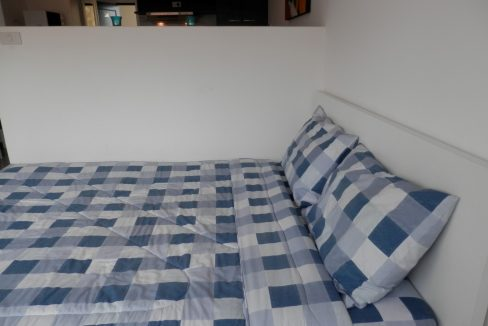 studio condo for rent with a comfortable bed